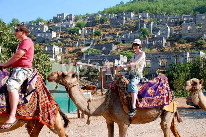 Camel trekking in ghost town