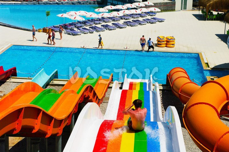 View on swimming pool from the top of slides