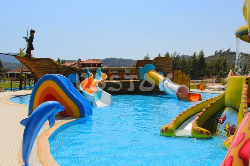 Children swimming pool with Octopus slide and Pirate Ship slide