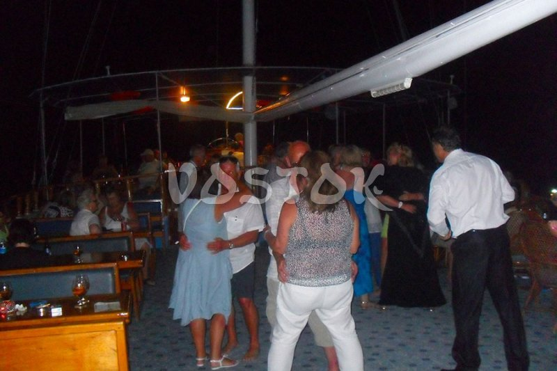 Dancing on the deck during the sunset cruise from Fethiye Turkey